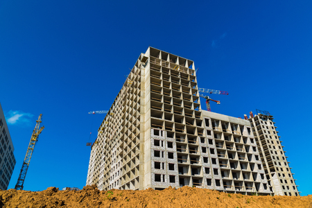 unfinished building: Construction of multi-storey houses in Moscow, Russia Stock Photo