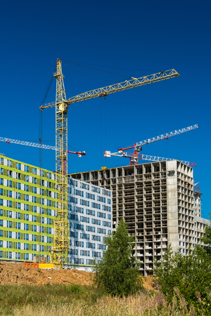 Construction of houses of different architecture in Moscow, Russia Stock Photo