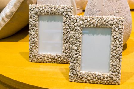 two empty photo frames on table Фото со стока