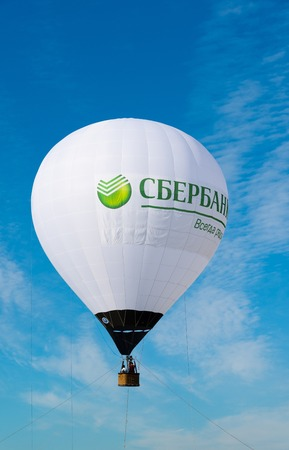motto: Zhukovsky, Russia - July 22. 2017. Balloon with Sberbank advertising and the slogan is always there