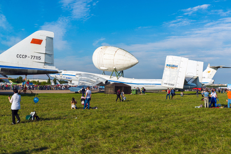 Zhukovsky, Russia - July 24. 2017. The people against the background of airplane m-4 Atlant with locator at the international aerospace show MAKS 2017