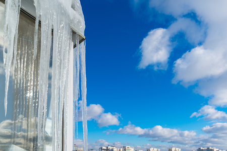 Icicles hang on balcony of house