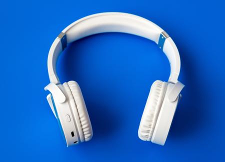 white wireless earphones on a blue background
