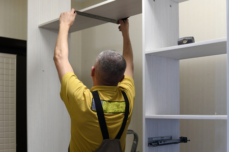 the master installs a wardrobe in the apartment