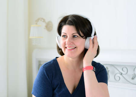 Portrait of a woman with wireless headphones. Stock Photo
