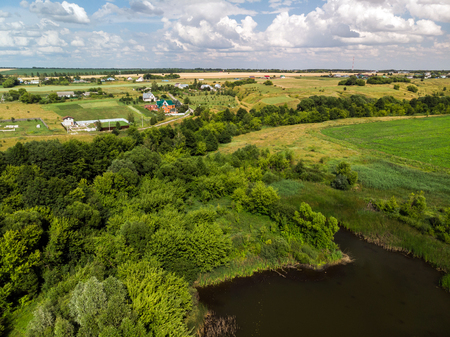 rural landscape with a forest and ponds in Russia, top view 免版税图像 - 104885217