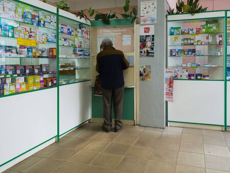 Gryazi, Russia - July 5. 2018. pensioner buys medicines in pharmacy in department of preferential provision