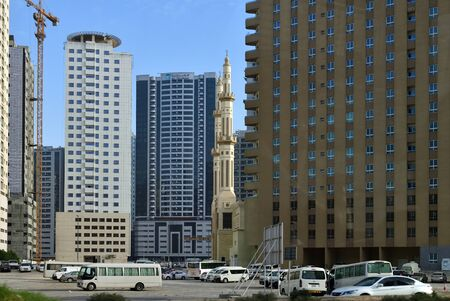 Dubai, UAE - April 10. 2018. a typical residential area with skyscrapers and a mosque
