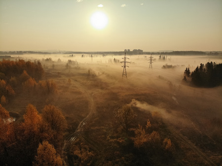 Flying over the countryside on a foggy morning in Russia