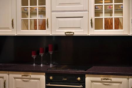 Beige kitchen set with stove in the room Reklamní fotografie