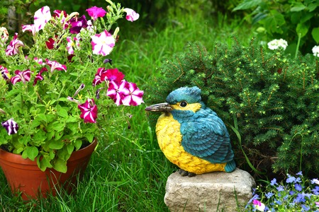 Potted flowers and garden sculpture of a bird