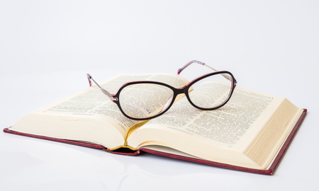 Stylish glasses for women with monofocal lenses and book Stock Photo
