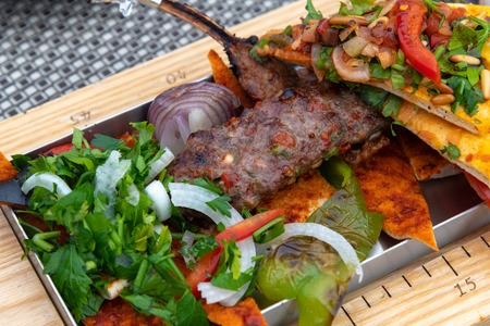 Adana-kebab with vegetables and pita bread - a traditional Turkish dish Stock Photo