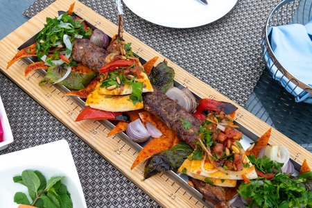 Adana-kebab with vegetables and pita bread - a traditional Turkish dish