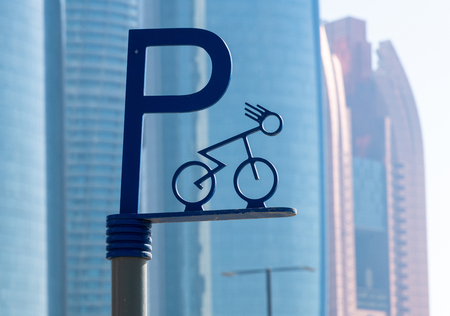 Bicycle parking sign on a background of skyscrapers. United Arab Emirates