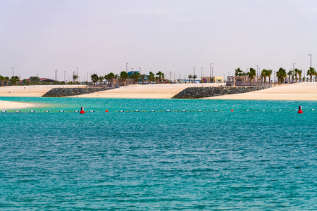 empty white sand beaches in Abu Dhabi, UAE View of city from sea