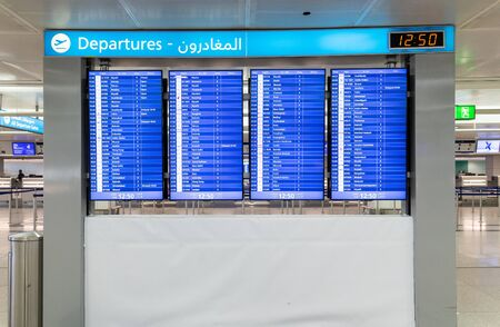 Dubai, UAE - April 2. 2019. Departure Scoreboard it DXB international airport