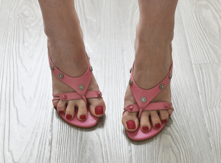 Womens legs in summer pink heeled sandals