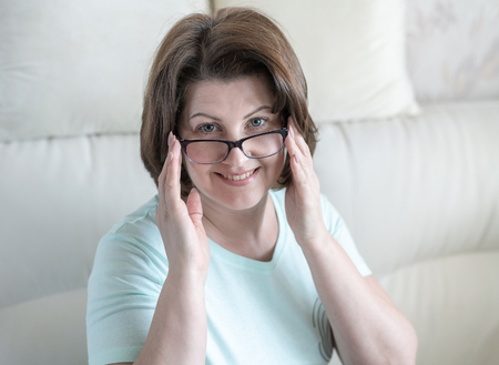 Portrait of a woman with glasses in home interior Stok Fotoğraf
