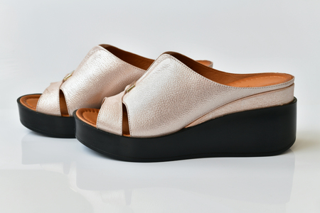 Beautiful female clogs on white background