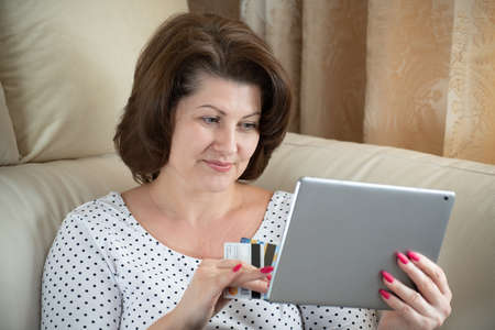 A woman makes a purchase on the Internet by credit card