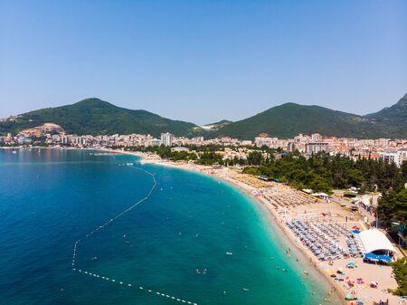 Aerial view of the long coastline of Budva city, Montenegro. Balkans, Adriatic sea, Europe