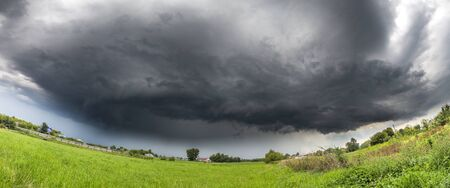 Panorama of Summer countryside landscape with a thundercloud