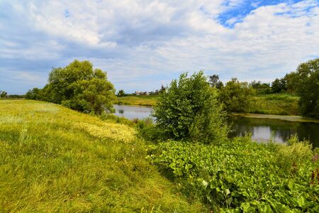 Landscape with a river in the countryside. Summertime