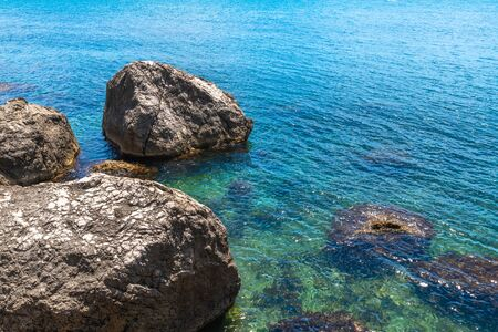 Beautiful seascape with stones on shore in Crimea Imagens - 130125246