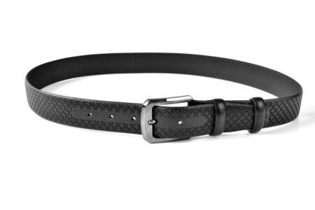 Thin black rolled belt on white background 版權商用圖片