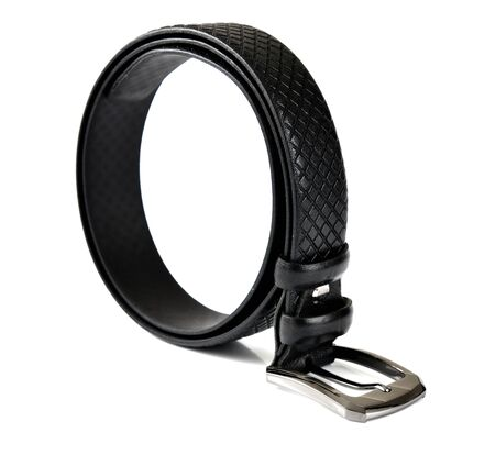 Thin black rolled belt on white background Reklamní fotografie