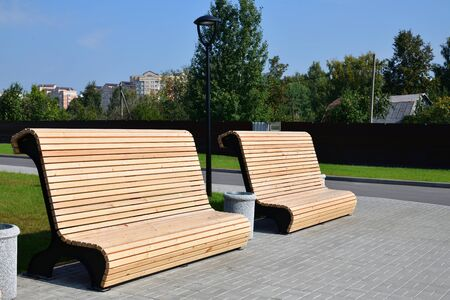 Beautiful wooden benches in a city park in Zelenograd in Moscow, Russia