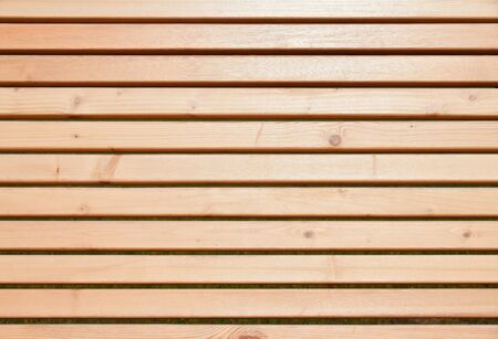 Background of wooden planks coated with a transparent varnish