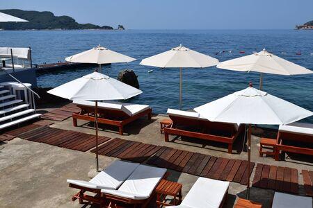 beach in the resort area with white umbrellas in Budva, Montenegro 版權商用圖片