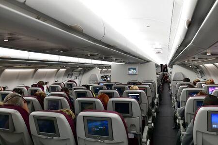 Doha, Qatar - Nov 24. 2019. Salon Airbus A320 Economy class of the Qatar Airways