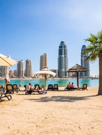 Doha, Qatar - Nov 11. 2019. Beach on background of skyscrapers on the Pearl Island