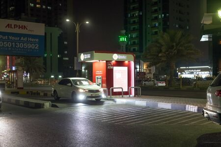 Ajman, UAE - April 6. 2018. ATM Ajman bank at the edge of the road to use without leaving the car. Local tradition