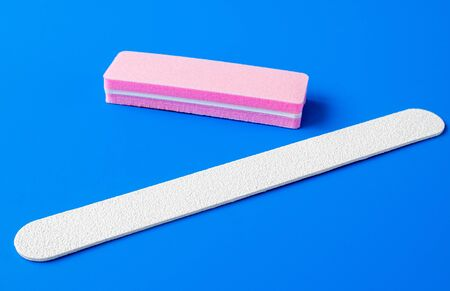Sanding file sponge for manicure on blue background