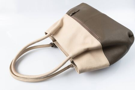 Brown leather women bag on white background Stockfoto