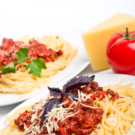 parmezan: servings of spaghetti bolognese with parmezan cheese