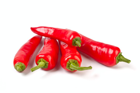 red chilly: group of five hot red chilly peppers Stock Photo