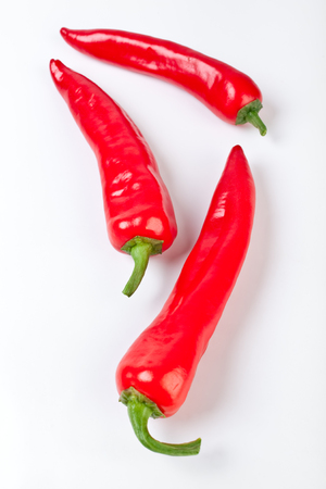 red chilly: group of three hot red chilly peppers Stock Photo