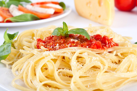 Linguine pasta with fresh tomato sauce and basil photo
