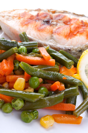 salmon steak with green beans on white plate photo