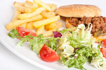 minced meat burger with french fries and salad photo