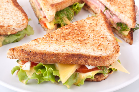 meat, lettuce and cheese sandwich on toasted bread photo