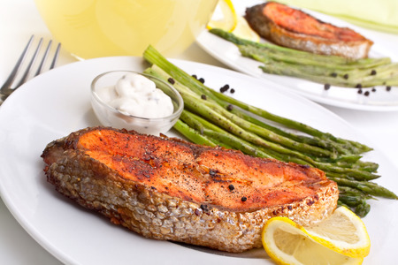 grilled salmon with asparagus, lemon and cream sauce photo