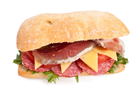 Ciabatta bread sandwich stuffed with meat,cheese and vegetables with cup of coffee photo