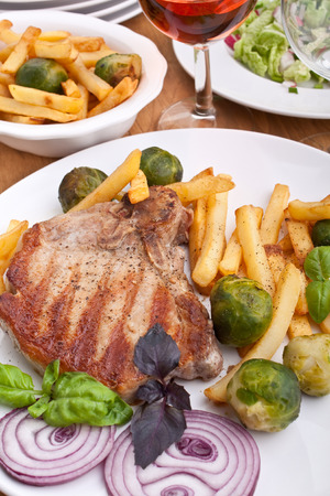cocaine: pork chops with french fries and brussels sprouts and red wine