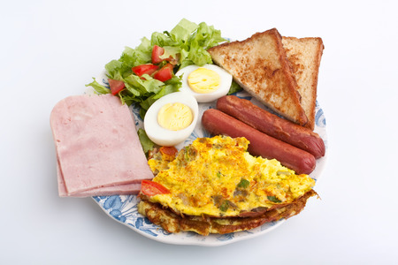 healthy breakfast with omelette, sausages, toast ad ham photo